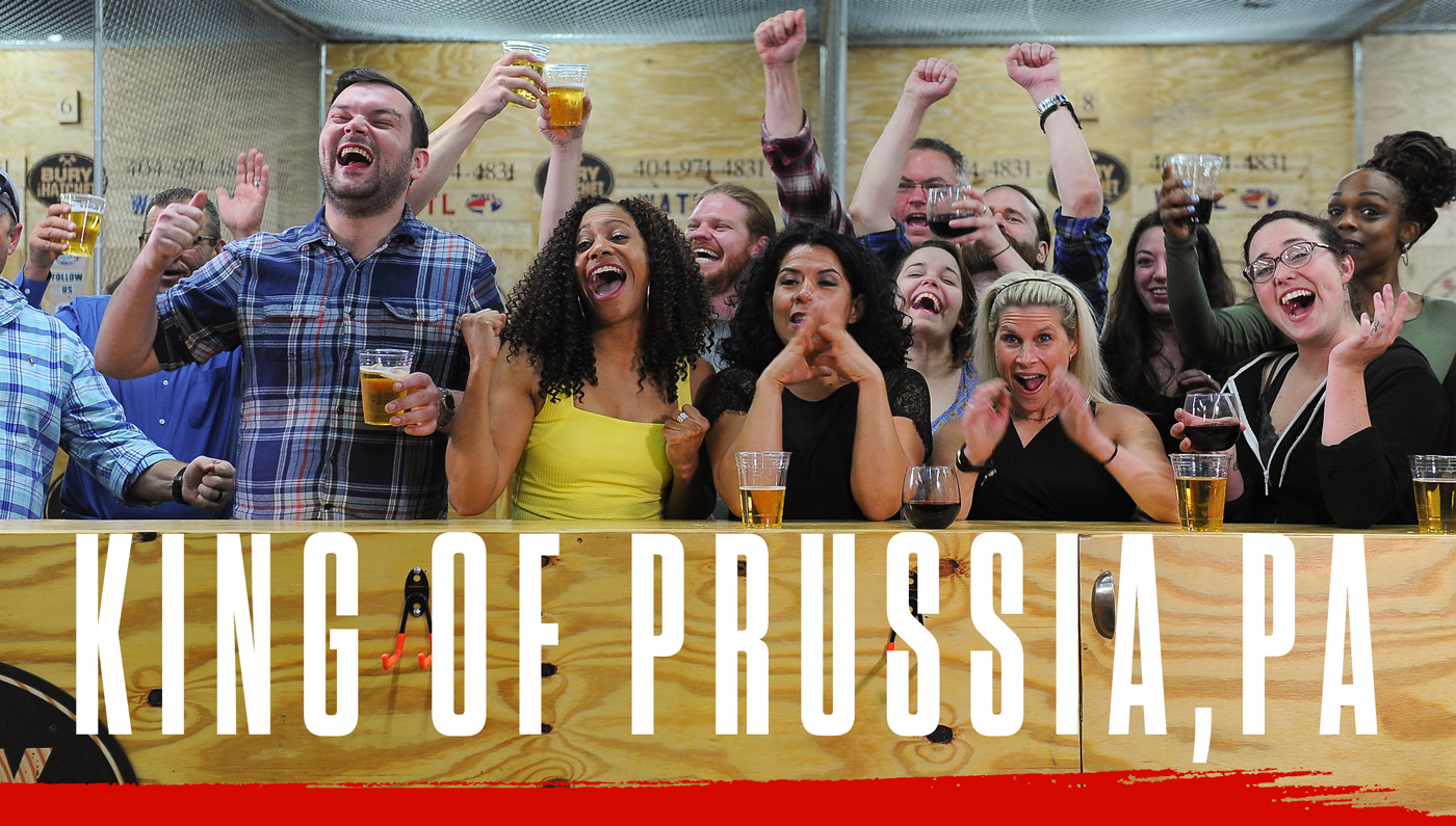 Bury The Hatchet King of Prussia PA City Page Header Image. Axe throwers celebrating with hands in air