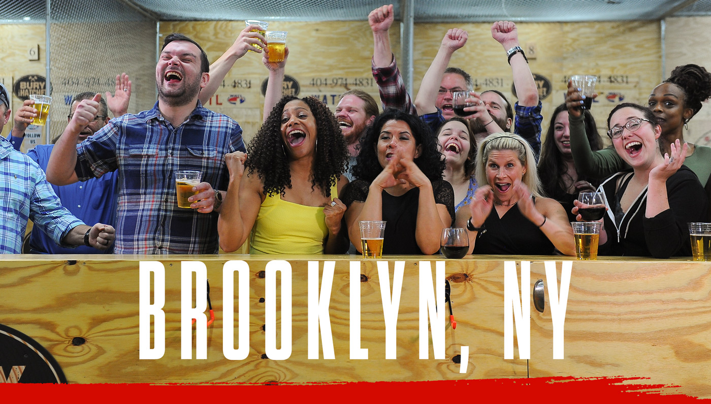 Bury The Hatchet Brooklyn NY City Page Header Image. Axe throwers celebrating with hands in air