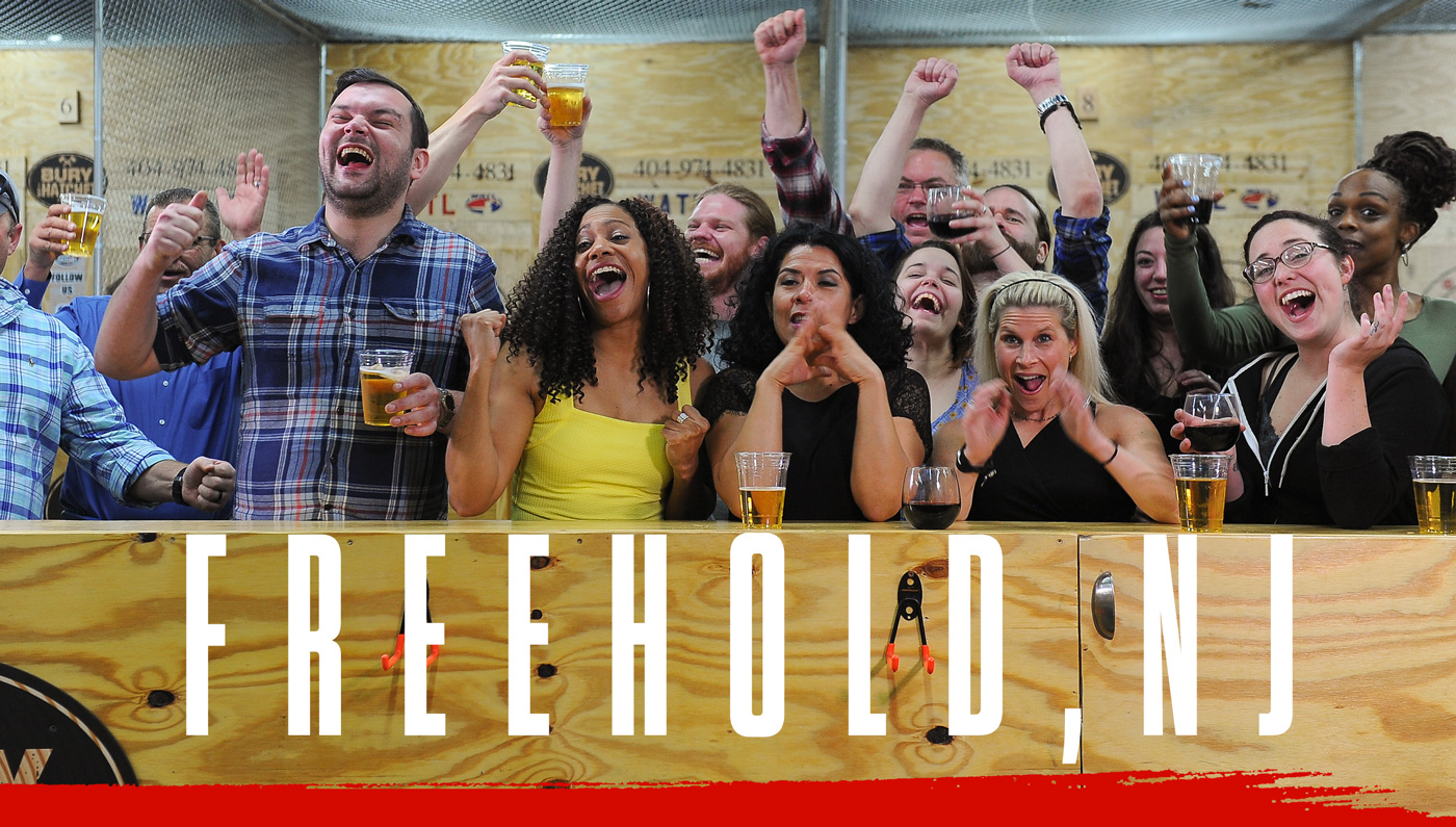 Bury The Hatchet Freehold NJ City Page Header Image. Axe throwers celebrating with hands in air