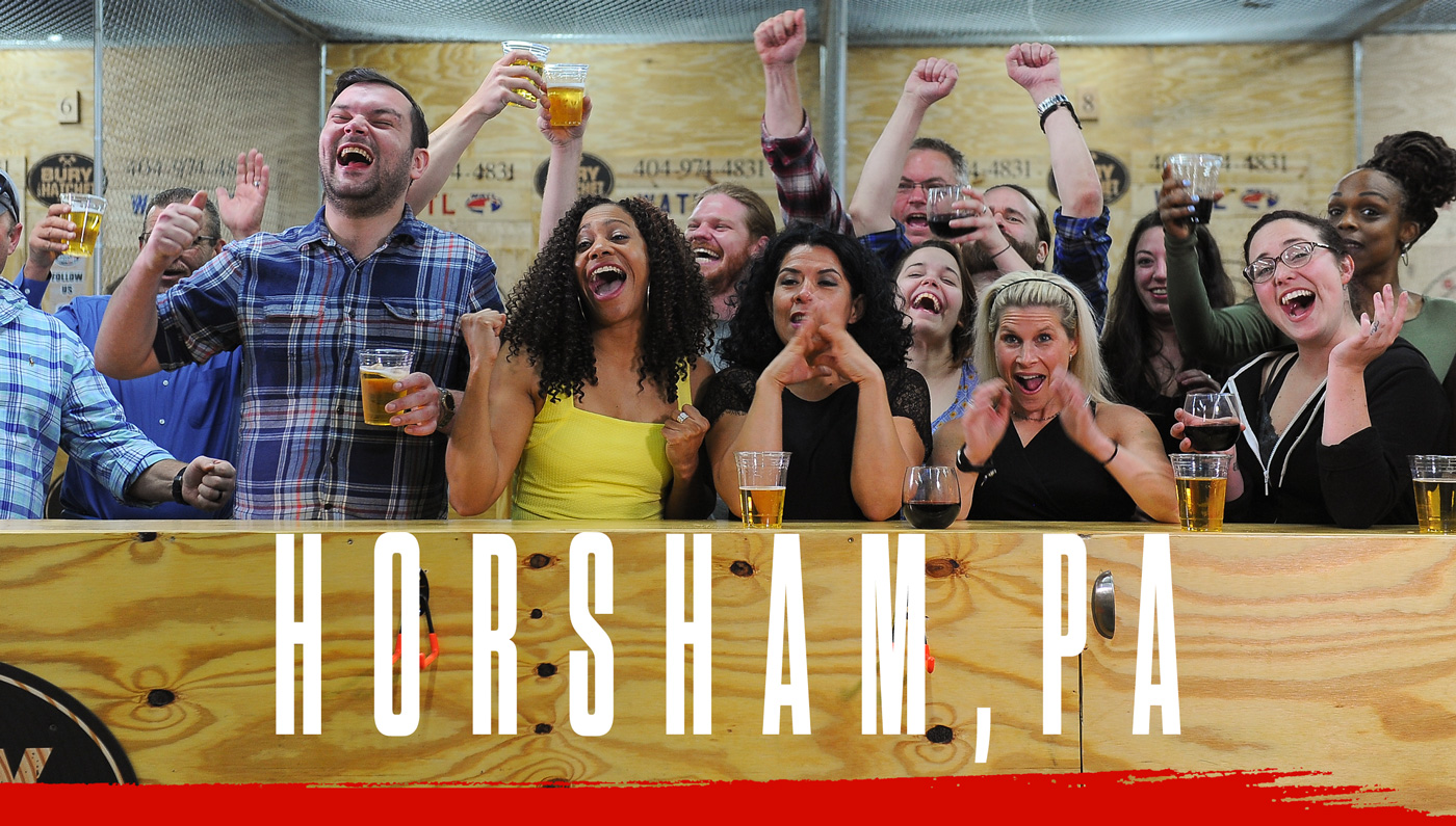 Bury The Hatchet Horsham PA City Page Header Image. Axe throwers celebrating with hands in air