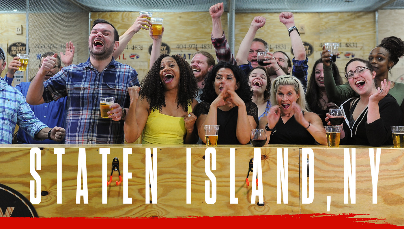 Bury The Hatchet Staten Island City Page Header Image. Axe throwers celebrating with hands in air